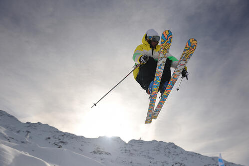 extreme freestyle ski jump with young man at mountain in snow park at winter season-2